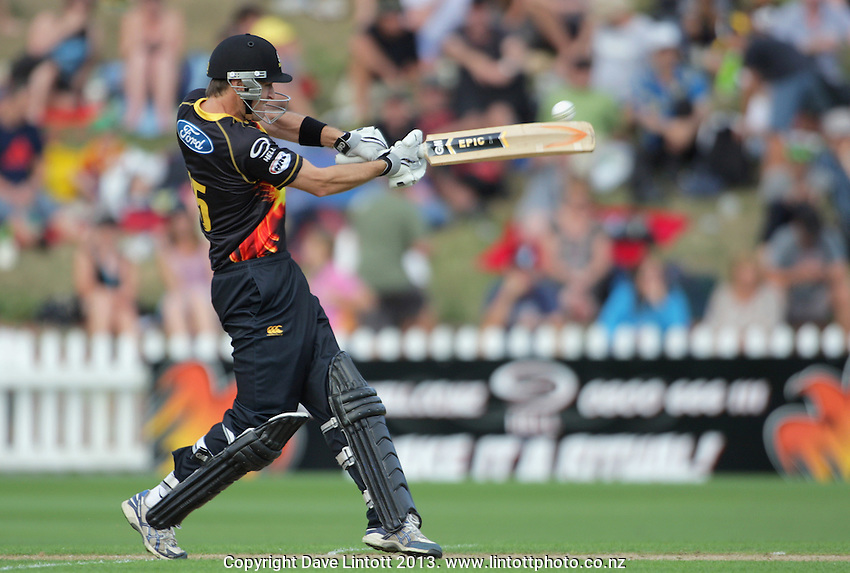 Cameron Borgas hits out during the HRV Cup Twenty20 cricket match between the Wellington Firebirds and Otago Volts at Hawkins Finance Basin Reserve, Wellington, New Zealand on Friday, 11 January 2013. Photo: Dave Lintott / lintottphoto.co.nz