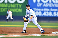Asheville Tourists first baseman Grant Lavigne (34) reacts to the ball during a game against the Charleston RiverDogs at McCormick Field on April 10, 2019 in Asheville, North Carolina. The  RiverDogs defeated the Tourists 5-3. (Tony Farlow/Four Seam Images)