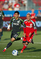 Seattle Sounders FC forward Fredy Montero #17 and Toronto FC defender Mikael Yourassowsky #19 in action during an MLS game between the Seattle Sounders FC and the Toronto FC at BMO Field in Toronto on June 18, 2011.