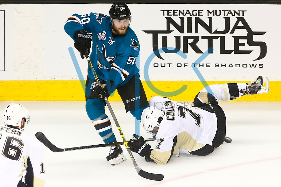 Matt Cullen #7 of the Pittsburgh Penguins slides into Chris Tierney #50 of the San Jose Sharks in the second period during game four of the Stanley Cup Final at the SAP Center in San Jose, California on June 6, 2016. (Photo by Jared Wickerham / DKPS)