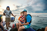 GALAPAGOS ISLANDS, ECUADOR, Father and Son travel in a zodiac as they leave Fernandina Island