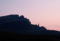 Silhouette of Old Man of Storr in dawn light, Isle of Skye, Scotland