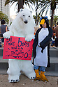 "People in polar bear and penguin costumes with ""Polar bears need us to get to 350"" sign. Hundreds of people gathered in downtown San Francisco for 350.org's International Day of Climate Action, October 24, 2009. Greenpeace, Mobilization for Climate Justice, and many others helped put on the local event. California, USA"