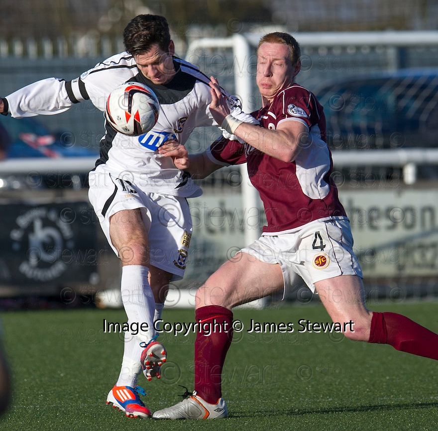 East Fife's Liam Buchanan and Stenny's Stewart Greacen challenge for the ball.<br /> <br /> <br /> 15/02/2014   jspa002_smuir_v_efife     <br /> Copyright  Pic : James Stewart   <br /> <br /> James Stewart Photography 19 Carronlea Drive, Falkirk. FK2 8DN      Vat Reg No. 607 6932 25   Tel:  +44 (0)7721 416997<br /> E-mail  :  jim@jspa.co.uk   If you require further information then contact Jim Stewart on any of the numbers above........
