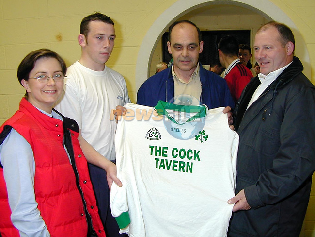 Tony Stafford from the Cock Tavern presenting a set of jerseys to Declan Russell, chairman St. Patrick's, Stamullen. Also pictured are Gwen Keogh, P.R.O. and Ronan Kierans..Picture Paul Mohan Newsfile