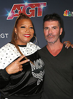 """HOLLYWOOD, CA - SEPTEMBER 10: Queen Latifah, Simon Cowell, at """"America's Got Talent"""" Season 14 Live Show Red Carpet at The Dolby Theatre  in Hollywood, California on September 10, 2019. Credit: Faye Sadou/MediaPunch"""