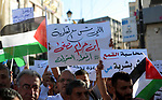 Palestinians take part in a protest calling on President Mahmoud Abbas to lift the sanctions on Gaza Strip, in Ramallah, in the occupied West Bank, June 23, 2018. Photo by Shadi Hatem