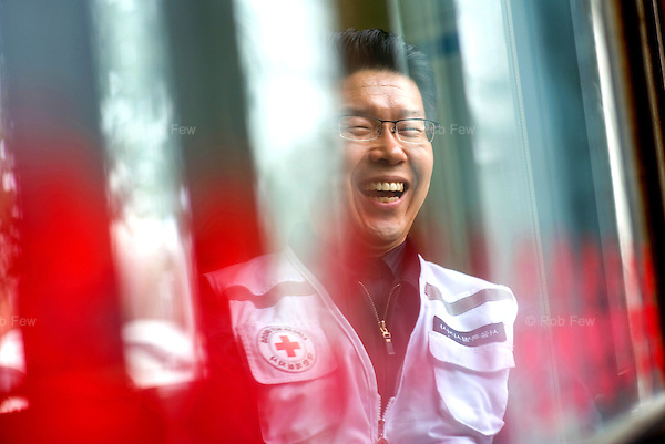 Cheul Su Lee, a Red Cross Volunteer Manager in Seoul.<br /> <br /> His staff deliver lunches to old and disabled people and provide laundry and other services for pensioners. For some people, particularly the old and sick, Red Cross volunteers can be the only visitors they ever have.