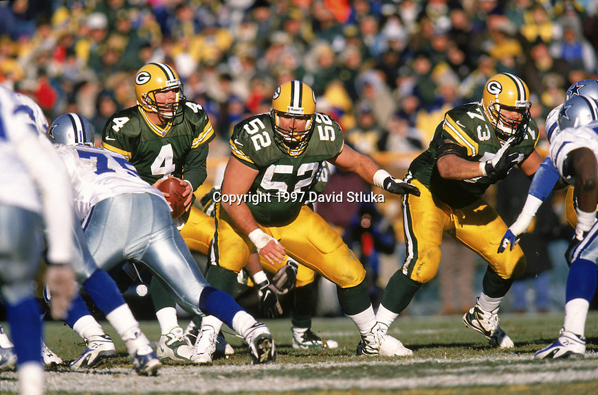 Green Bay Packers offensive lineman Frank Winters (52) and Aaron Taylor (73) block for quarterback Brett Favre (4) during an NFL football game against the Dallas Cowboys at Lambeau Field on November 23,1997 in Green Bay, Wisconsin. The Packers won 45-17. (Photo by David Stluka)