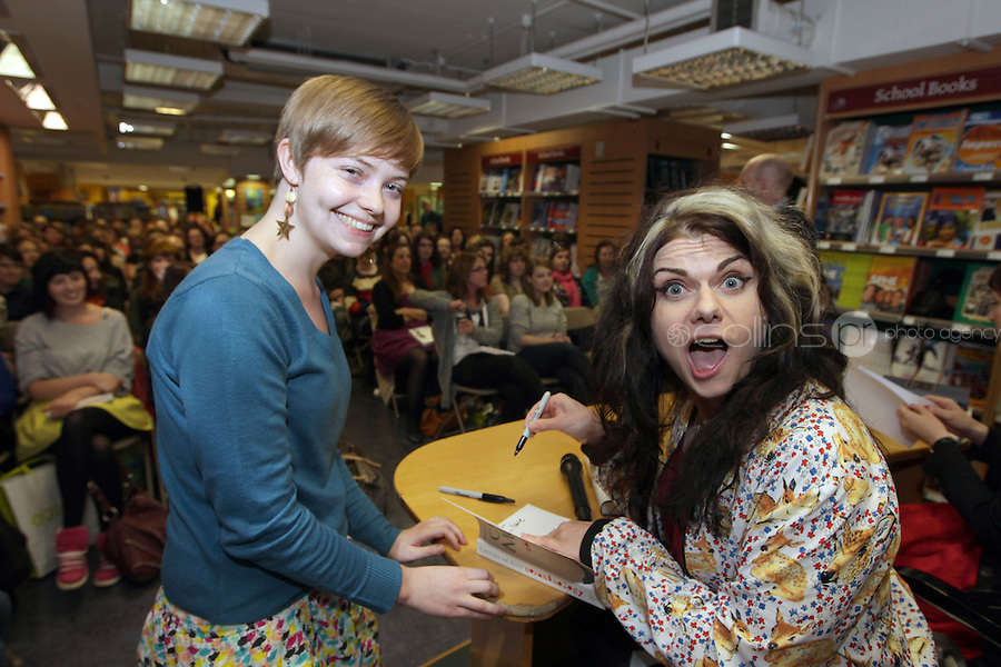 NO FEE PICTURES.21/9/12 Claire Kruger, Drogheda gets her book signed at Eason on O'Connell St, by bestselling author of How To Be a Woman and Moranthology Caitlin Moran.Picture:Arthur Carron/Collins