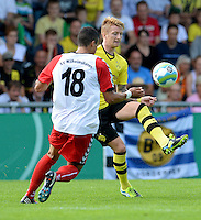 FUSSBALL       DFB POKAL 1. RUNDE        SAISON 2013/2014 SV Wilhelmshaven - Borussia Dortmund    03.08.2013 Marco Reus (re, Borussia Dortmund) gegen Angelos Eleftheriadis (li, Wilhelmshaven)