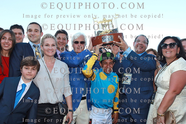 The connections of American Pharoah, including Trainer Bob Baffert, Jockey Victor Espinoza and Owner Ahmed Zayat hold up the Haskell Trophy after American Pharoah captured top honors in the $1,750,000 Grade 1 William Hill Haskell Invitational at Monmouth Park in Oceanport, New Jersey on Sunday August 2, 2015.  Photo By Bill Denver/EQUI-PHOTO.