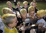 (Worcester Ma 111613) Belchertown sinks their teeth into the state trophy,  celebrating their overtime win, during the MIAA Division Three Boys Soccer Final between Belchertown High and Medway High, Saturday night at Foley Field in Worcester. (Jim Michaud Photo) For Sunday