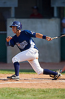 Gerardo Olivares #28 of the Princeton Rays follows through on his swing against the Bluefield Orioles at Hunnicutt Field July 4, 2010, in Princeton, West Virginia.  Photo by Brian Westerholt / Four Seam Images