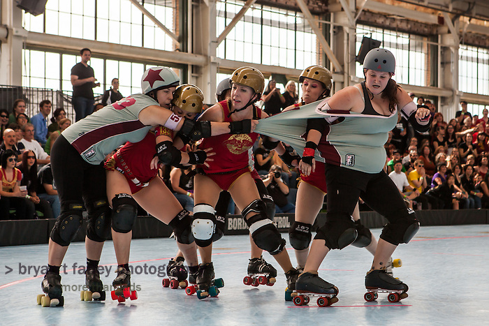 """The tenth seeded Sacred City Derby Girls from Sacramento defeated the eighth seeded Angel City (Los Angeles) Derby Girls 147-146 for seventh place at the 2012 Women's Flat Track Derby Association (WFTDA) Western Region Playoffs at Craneway Pavillion in Richmond, California on September 21-23. WFTDA, the international governing body of women's flat track roller derby, """"promotes and fosters the sport of women's flat track roller derby by facilitating the development of athletic ability, sportswomanship, and goodwill among member leagues."""""""