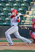 Spencer Kieboom (20) of the Hagerstown Suns follows through on his swing against the Hickory Crawdads at L.P. Frans Stadium on May 7, 2014 in Hickory, North Carolina.  The Suns defeated the Crawdads 4-2.  (Brian Westerholt/Four Seam Images)