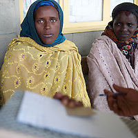 Abbaynesh Metu, 26 years old, being interviewed by health extension worker Ayalam Barharan, 24 years at the Cholga health center in  rural Ethiopia on August 24, 2010.