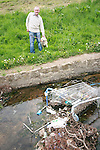 Cllr Frank Gallagher shows the rubbish in the waterway in the Glen, Newfoundwell Road...Photo NEWSFILE/Jenny Matthews.(Photo credit should read Jenny Matthews/NEWSFILE)....This Picture has been sent you under the condtions enclosed by:.Newsfile Ltd..The Studio,.Millmount Abbey,.Drogheda,.Co Meath..Ireland..Tel: +353(0)41-9871240.Fax: +353(0)41-9871260.GSM: +353(0)86-2500958.email: pictures@newsfile.ie.www.newsfile.ie.FTP: 193.120.102.198.