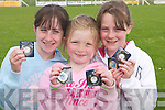 SHOWING: Kirby Kissane, Ciara Leane and Holly Carroll showing off their medals at the Ballyheigue Community Games on Sunday..