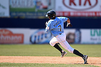 Wilmington Blue Rocks shortstop Raul Mondesi (7) runs the bases after hitting a triple during a game against the Myrtle Beach Pelicans on April 27, 2014 at Frawley Stadium in Wilmington, Delaware.  Myrtle Beach defeated Wilmington 5-2.  (Mike Janes/Four Seam Images)