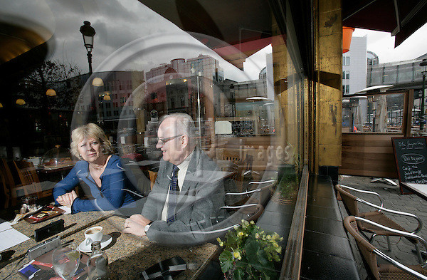 BRUSSELS - BELGIUM - 21 MARCH 2007 --ÊKarin RIIS-J¯RGENSEN and Jens-Peter BONDE, both MEPs during a interview in a cafe. Here seen through the window where parliament buildings are mirrored.  PHOTO: ERIK LUNTANG / EUP-IMAGES