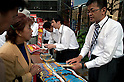 Staff at Post Offices in Tokyo sell special glasses as the country gets ready to witness a partial solar eclipse on Monday 21st May. The path of Monday's eclipse runs almost directly over Tokyo and it is said to be a once in 300 year chance to see the phenomenon from the Japanese capital. News programs are running features about how to view the sun safely and convenience and electronics stores are selling viewing goods. According to NASA peak viewing time should start around 06:32am on Monday in Tokyo and lasts just five minutes.