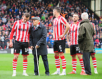 Lincoln City's Harry Toffolo with one of the club's 'older mascots' prior to kick off<br /> <br /> Photographer Chris Vaughan/CameraSport<br /> <br /> The EFL Sky Bet League Two - Lincoln City v Crewe Alexandra - Saturday 6th October 2018 - Sincil Bank - Lincoln<br /> <br /> World Copyright &copy; 2018 CameraSport. All rights reserved. 43 Linden Ave. Countesthorpe. Leicester. England. LE8 5PG - Tel: +44 (0) 116 277 4147 - admin@camerasport.com - www.camerasport.com