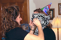 Mom checking mask for blindman's bluff party game age 32.  Brooklyn Park Minneapolis St Saint Paul Minnesota USA