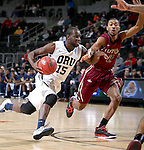 SIOUX FALLS, SD - MARCH 8: Obi Emegano #15 of Oral Roberts drives the basket against Mason Archie #2 of IUPUI in the first half of their second round Summit League Championship Tournament game Sunday evening at the Denny Sanford Premier Center in Sioux Falls, SD. (Photo by Dave Eggen/Inertia)