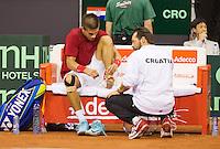 September 12, 2014, Netherlands, Amsterdam, Ziggo Dome, Davis Cup Netherlands-Croatia, Borna Coric get treatment on his foot(CRO)<br /> Photo: Tennisimages/Henk Koster