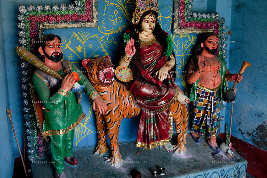The tribal goddess Bono Debi/Bono Bibi on Gosaba island, Sundarban, West Bengal, India, on 18th January, 2012. A tiger hid in this temple after attacking a woman. Villagers pray to this endemic goddess, known as Bono Debi to Hindus and Bono Bibi to Muslims, to protect them from tigers. Tigers have been known to swim, sometimes underwater, to the village to hunt humans. A successful Royal Bengal tiger breeding program has increased their numbers but decreased the number of husbands. There are now an estimated 3,000 widows in the villages where their husbands, have been killed by tigers. Photo by Suzanne Lee for The National (online byline: Photo by Szu for The National)