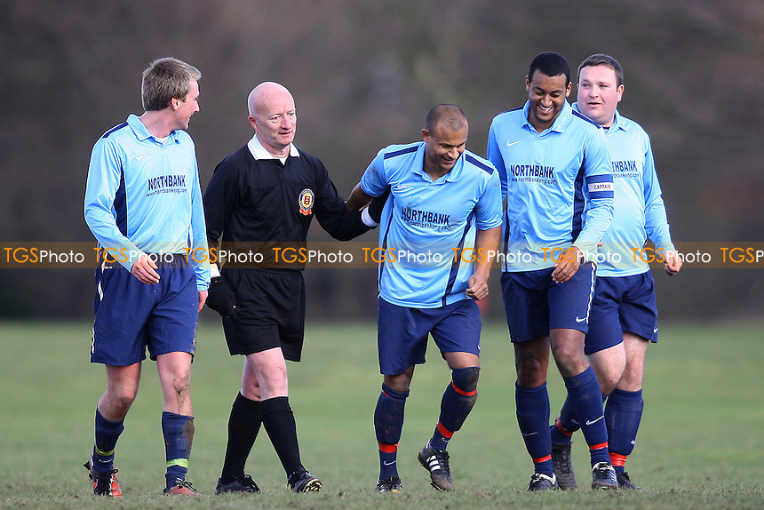 EMWA (Blue Top) v E16 Elite (Yellow)- Essex Sunday Corinthian Cup Football - Seven Kings Park 19/02/12 - MANDATORY CREDIT: George Phillipou/TGSPHOTO - Self billing applies where appropriate - 0845 094 6026 - contact@tgsphoto.co.uk - NO UNPAID USE.