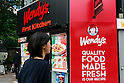 A woman walks past a combined Wendy's and First-Kitchen joint fast food restaurant in Ueno on May 24, 2016, Tokyo, Japan. Japanese beverage manufacturer Suntory Holdings Ltd. announced on Monday that it will sell its shares in the First-Kitchen Ltd. hamburger chain to Wendy's Japan LLC. The First-Kitchen chain, which was launched in 1977, operates some 135 outlets in the Tokyo metropolitan area and western Japan and had sales of ¥8.7 billion ($79 million) in 2015. Wendy's plans to keep the First-Kitchen brand after the acquisition and operate joint branded restaurants. (Photo by Rodrigo Reyes Marin/AFLO)