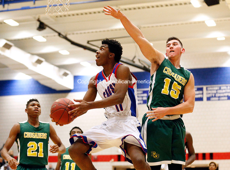 Waterbury, CT- 13 January 2016-011316CM06-  Crosby's Jeremiah Kendall, takes the ball to the hoop around Holy Cross' Justin Strielkauskas during their NVL matchup in Waterbury on Wednesday.  Crosby would go onto win, 66-59.   Christopher Massa Republican-American