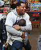 Dominic Smith, New York Mets rookie first baseman, hugs Jayden Oche during the team's Holiday Shopping Spree at Target in Elmhurst, NY on Wednesday, Nov. 29, 2017.