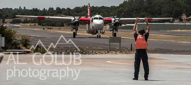 July 10, 2013--Cal Fire Columbia Air Attack Base is located at the Columbia Airport, Columbia, California.  In the summer of 2013 Frank Podesta was the Battalion Chief.  Assigned to the base was Helitack crew 404, a OV-10 Bronco (air command) and two S-2T air tankers.   On average, the base pumps about 600,000 gallons of retardant a year.  With the base's pumps, three loading pits and equipment.  At full peak, they can output 120,000 gallons of retardant a day.  Photo by Al Golub/Golub Photography