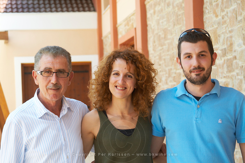 Ageliki Biba, oenologist winemaker and Yiannis Papadopoulos, owner, with son. Wine Art Estate Winery, Microchori, Drama, Macedonia, Greece