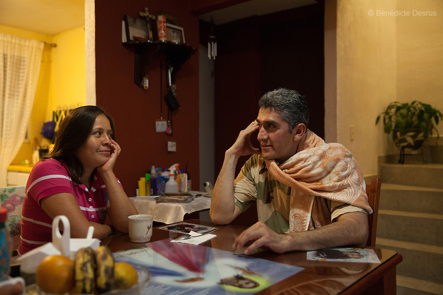 "Donovan listens to classical music on his phone while drinking coffee with his wife at their home in Texcoco, Mexico on May 21, 2015. Donovan Tavera, 43, is the director of ""Limpieza Forense México"", the country's first and so far the only government-accredited forensic cleaning company. Since 2000, Tavera, a self-taught forensic technician, and his family have offered services to clean up homicides, unattended death, suicides, the homes of compulsive hoarders and houses destroyed by fire or flooding. Despite rising violence that has left 70,000 people dead and 23,000 disappeared since 2006, Mexico has only one certified forensic cleaner. As a consequence, the biological hazards associated with crime scenes are going unchecked all around the country. Photo by Bénédicte Desrus"