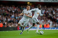 LONDON, ENGLAND - MAY 11( L-R )  Angel Rangel of Swansea City  and Nathan Dyer of Swansea City  in action  during  to the Premier League match between Arsenal and Swansea City at Emirates Stadium on May 11, 2015 in London, England.  (Photo by Athena Pictures/Getty Images)