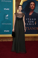 "HOLLYWOOD, CA - FEBRUARY 13: Caitriona Balfe, at the Premiere Of Starz's ""Outlander"" Season 5 at HHollywood Palladium in Hollywood California on February 13, 2020. Credit: Faye Sadou/MediaPunch"