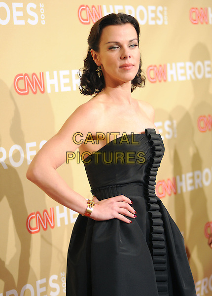 DEBI MAZAR .at The 3rd Annual CNN Heroes: An All-Star Tribute held at The Kodak Theatre in Hollywood, California, USA,  November 21st 2009                                                                   .half length strapless black dress hand on hip gold bracelet centre ruffle .CAP/RKE/DVS.©DVS/RockinExposures/Capital Pictures