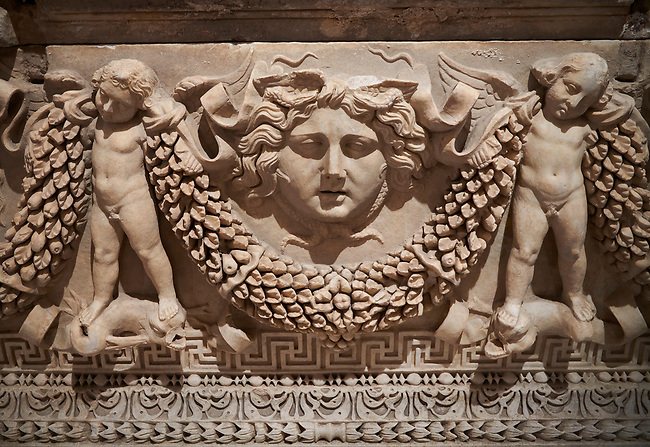 """Picture of Roman relief sculpted Sarcophagus of Garlands, 2nd century AD, Perge. This type of sarcophagus is described as a """"Pamphylia Type Sarcophagus"""". It is known that these sarcophagi garlanded tombs originated in Perge and manufactured in the sculptural workshops of Perge. Antalya Archaeology Museum, Turkey."""