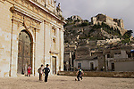 Sicilian children playing soccer in front of church Scicli.