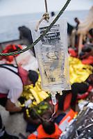 Sea Watch-2.<br /> Die Sea Watch-2 bei ihrer 13. SAR-Mission vor der libyschen Kueste.<br /> Im Bild: Eine Gefluechtete an Bord der Sea Watch-2 wird medizinisch versorgt.<br /> 21.10.2016, Mediterranean Sea<br /> Copyright: Christian-Ditsch.de<br /> [Inhaltsveraendernde Manipulation des Fotos nur nach ausdruecklicher Genehmigung des Fotografen. Vereinbarungen ueber Abtretung von Persoenlichkeitsrechten/Model Release der abgebildeten Person/Personen liegen nicht vor. NO MODEL RELEASE! Nur fuer Redaktionelle Zwecke. Don't publish without copyright Christian-Ditsch.de, Veroeffentlichung nur mit Fotografennennung, sowie gegen Honorar, MwSt. und Beleg. Konto: I N G - D i B a, IBAN DE58500105175400192269, BIC INGDDEFFXXX, Kontakt: post@christian-ditsch.de<br /> Bei der Bearbeitung der Dateiinformationen darf die Urheberkennzeichnung in den EXIF- und  IPTC-Daten nicht entfernt werden, diese sind in digitalen Medien nach §95c UrhG rechtlich geschuetzt. Der Urhebervermerk wird gemaess §13 UrhG verlangt.]