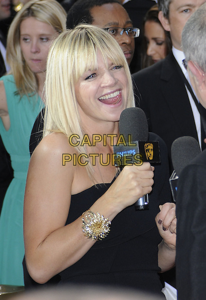 ZOE BALL.The Philips British Academy Television Awards, Grosvenor house Hotel, Park Lane, London, England, UK, May 22nd 2011..arrivals TV Baftas Bafta half length black one shoulder dress microphone mouth open funny bracelet silver grey gray.CAP/CAN.©Can Nguyen/Capital Pictures.
