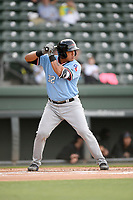 Catcher Melvin Novoa (32) of the Hickory Crawdads bats in a game against the Greenville Drive on Wednesday, May 15, 2019, at Fluor Field at the West End in Greenville, South Carolina. Greenville won, 6-5. (Tom Priddy/Four Seam Images)