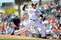Baltimore Orioles pitcher Miguel Gonzalez #50 delives a pitch during a Spring Training game against the New York Mets at Ed Smith Stadium on March 30, 2013 in Sarasota, Florida.  (Mike Janes/Four Seam Images)