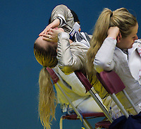 27 FEB 2011 - LONDON, GBR - American Mariel Zagunis recovers after her team was knocked out of fencing's England Cup team sabre tournament by China (PHOTO (C) NIGEL FARROW)