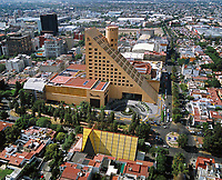 aerial photograph of Palacio de Hierro department store the chains flagship store in Mexico City; in the foreground is the San Ignacio de Loyola church