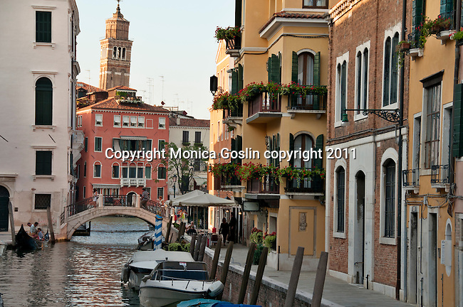 Looking down a canal in Venice, Italy lined with colorful buildings
